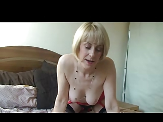 golden-haired mother i on the sofa in nylons