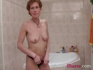 curly aged pees and takes a shower