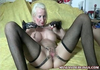 pierced granny with chains to her pierced pussy