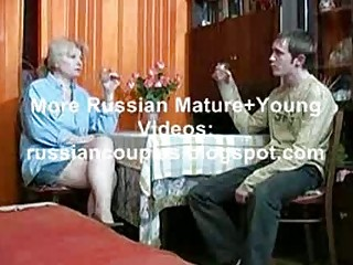 russian mamma and boy having a drink