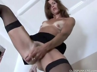 appealing aged red head in stockings