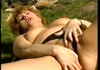 moist older wife masturbating in the garden by