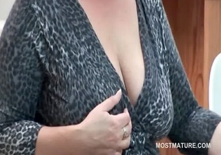 office lady teasing her older boobs with a banana