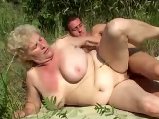 german granny outdoor with young dude by troc